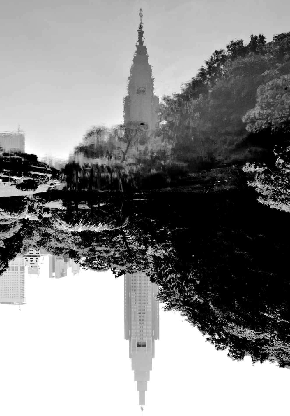 The vivid NTT DoCoMo building reflected in one of the many parks ponds.